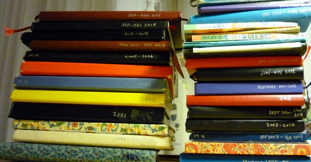 Stacks of journals with dates on bound edge