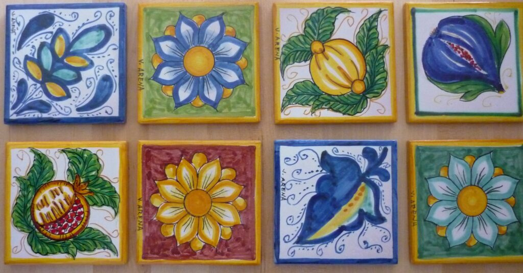 Handpainted tiles with bright yellows, blues, reds and greens.