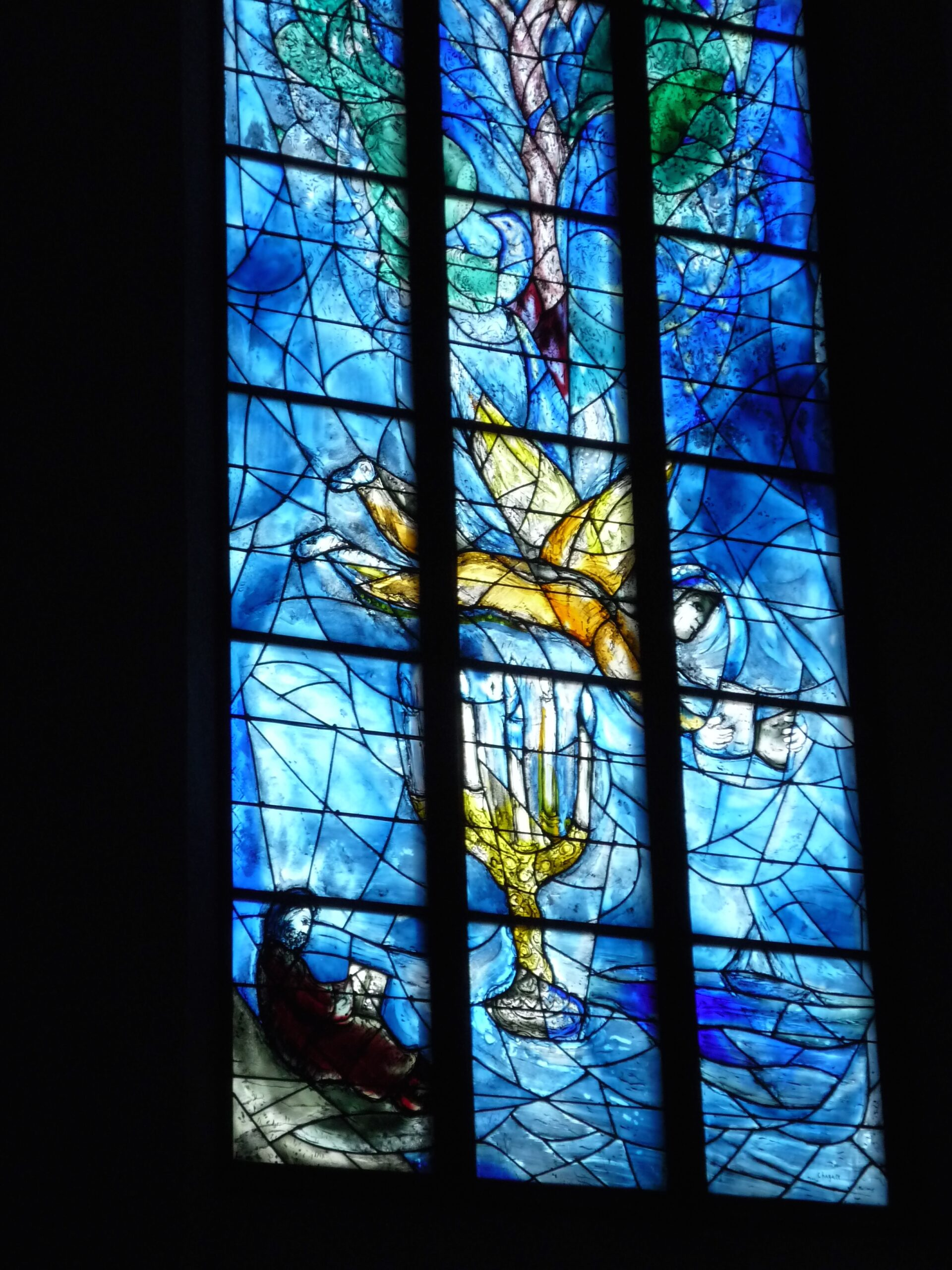 """""""Your Word is Lamp unto My Feet."""" Stained glass window in shades of blues with flying angel and candelabra by Marc Chagall/ Charles Marq. Pfarrkirche St. Stephan, Mainz, Germany, 2016."""