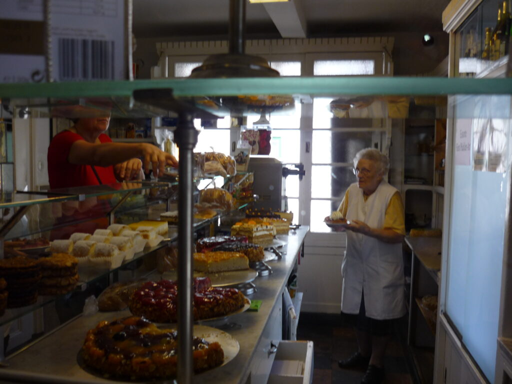 woman working in bakery with beautiful tortes