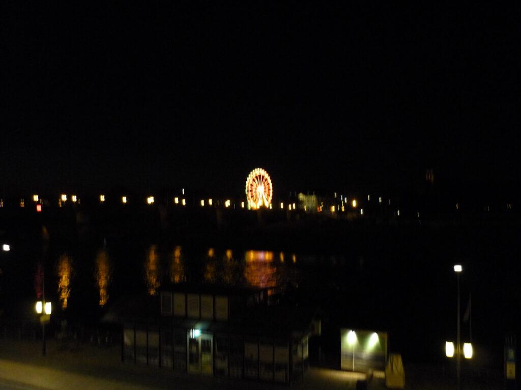 ferris wheel lit up against dark night