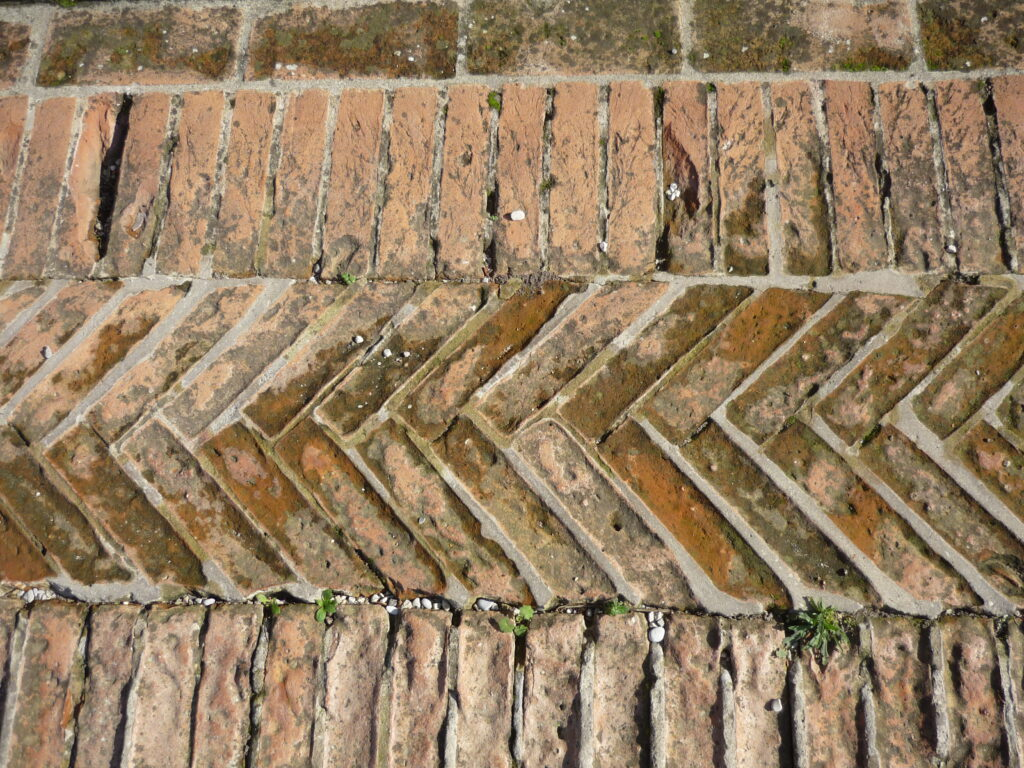 1000-year-old brick paving in a herringbone pattern.