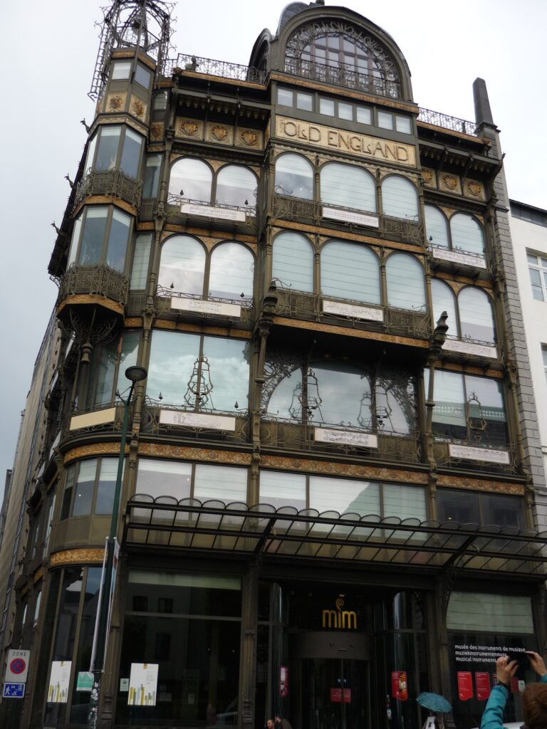 Art Deco building with musical motifs under every window showing the history of written music