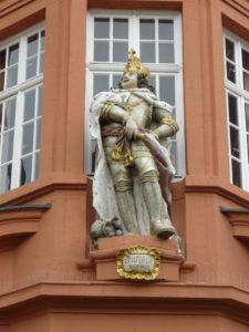 Gilded roman emperor on facade of Gutenberg Museum