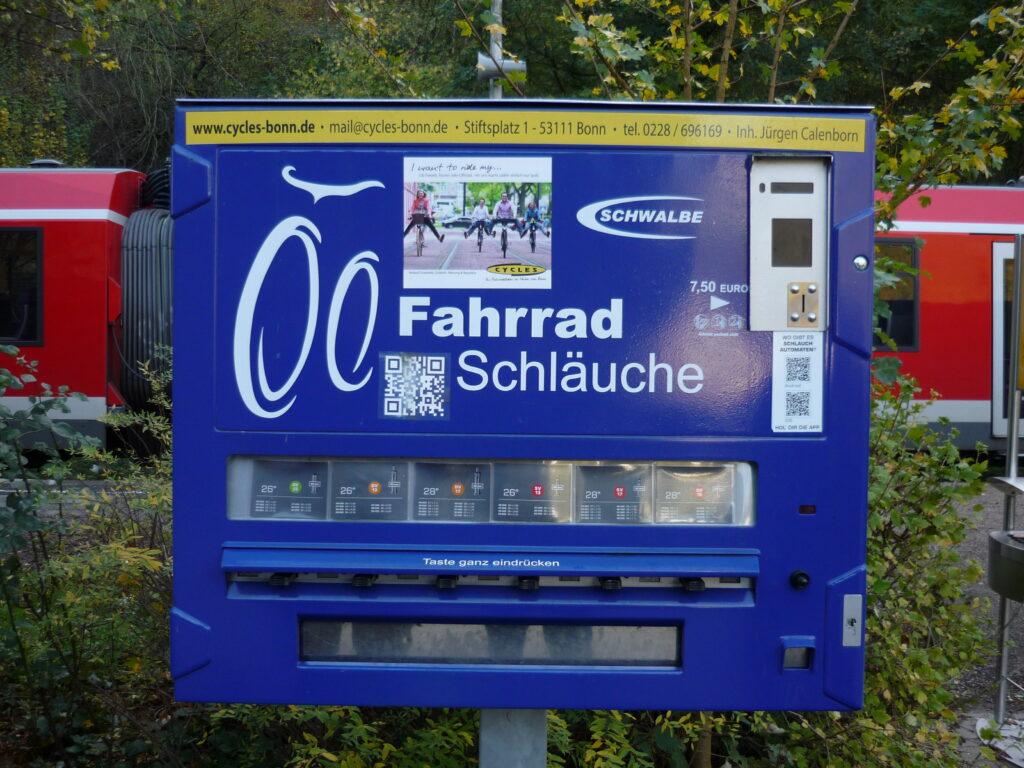 bright blue vending machine for bike inner tubes