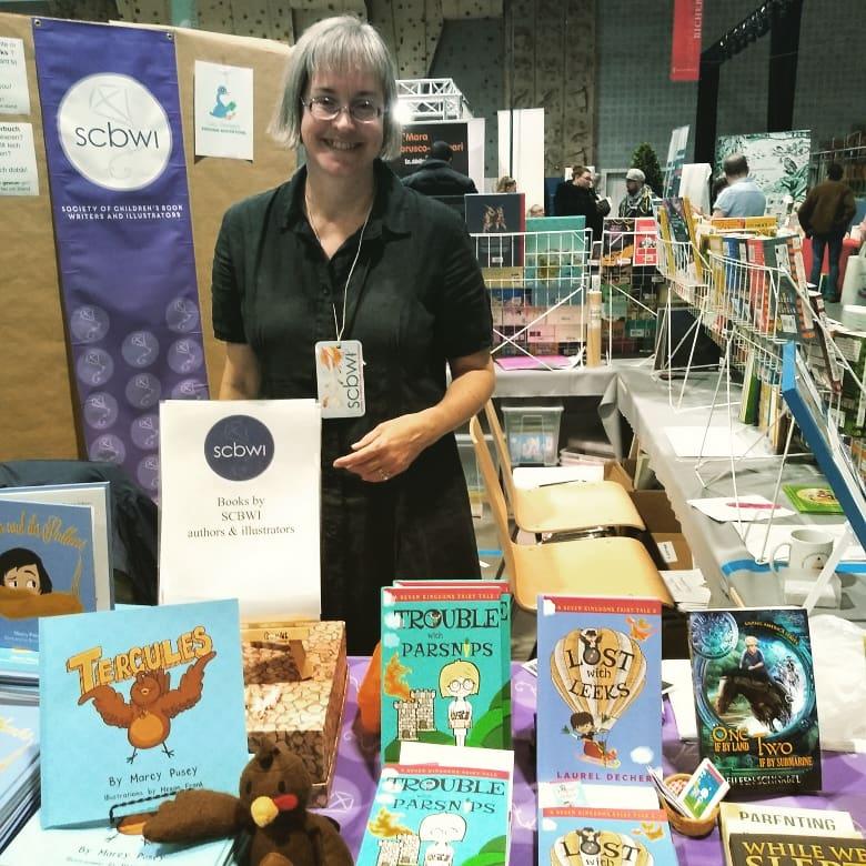 Laurel Decher with Seven Kingdoms Fairy Tales at walferbicherdeeg book fair