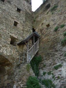 ancient castle wall with steep roofed stairs