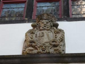 Horrified stone face on castle decoration