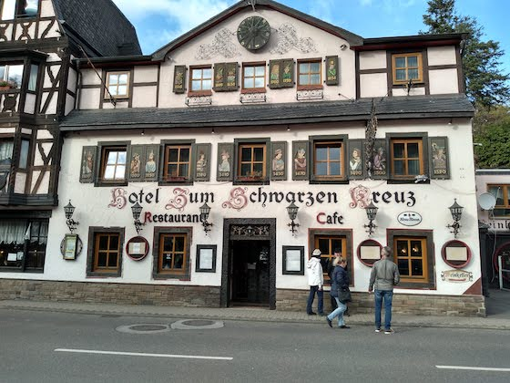 A reading list is like a hotel with windows Hotel in Germany with antique writing and carved decorations